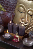 Asiatic decoration in brown and gold with buddha and candles. — Stok fotoğraf