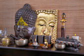 Asiatic decoration in brown and gold with buddha and candles. — Stock Photo