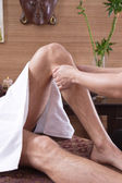 Man at foot massage in a original thai spa — Stock Photo