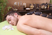 Traditional thai massage - man getting hotstone treatment — Stock Photo