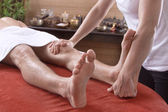 Man at foot massage in a original thai spa — Stockfoto