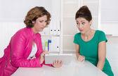 Two businesswomen working with tablet-pc at office. — Stock Photo