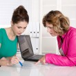 Good teamwork under women - female cooperation. — Stock Photo