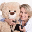 Happy medical doctor for children with a teddy bear. — Photo #40540707