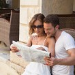 Handsome couple looking at road map. — Stock Photo
