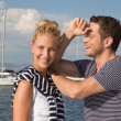Portrait of attractive young couple in love on sailing boat. — Stock Photo