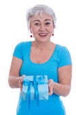 Older woman isolated in white with a turquoise shirt and a prese — Stockfoto