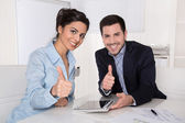 Successful team with thumbs up at office. — Stock Photo