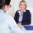 Interview with two businesswomen at desk at office. — Stock Photo #40837655