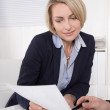 Business man and business woman working together at office. — Stock Photo