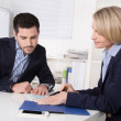 Interview with manager and young attractive man at office. — Stock Photo #40841069