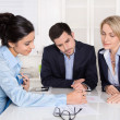 Business meeting at office with three business people. — Stock Photo