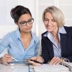 Successful teamwork under businesswoman at desk. — Stock Photo #41324951