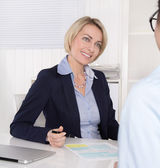Interview with young female and mature manager at office. — Stock Photo