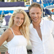 Young blonde and pretty couple on summer holidays with her saili — Stock Photo