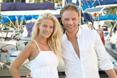 Young blonde and pretty couple on summer holidays with her saili — Stockfoto
