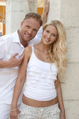 Young blond german couple in summer holiday in white cotton clot — Stock Photo