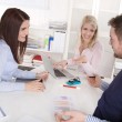 Team meeting with attractive businessman and two businesswomen. — Stock Photo