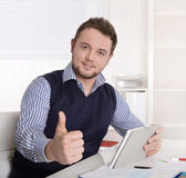 Young attractive successful manager with thumb up at office. — Stock Photo