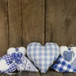Handmade blue hearts of fabric — Stock Photo