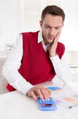 Pensive bookkeeper working with graphs at desk at office. — Foto Stock