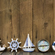 Sailing holiday: Greeting card with nautical items on a wooden b — Stock Photo #42048159