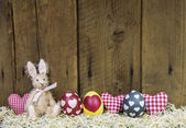 Rustic easter wooden background for a greeting card with eggs, h — Stock Photo