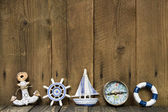 Sailing holiday: Greeting card with nautical items on a wooden b — Stock Photo