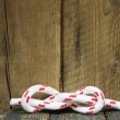 Sailors knot on a wooden background for sailing concepts. — Stock Photo