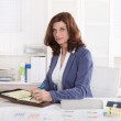 Portrait: Successful older business woman sitting in her office. — Stock Photo