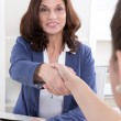 Handshake: Female financial adviser with his customer. — Stock Photo