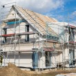 Construction of a new prefabricated house of stone and wood. — Stock Photo