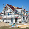 Construction of a new prefabricated house of stone and wood. — Stock Photo #42461493