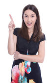 Happy smiling young woman showing finger in blank area. — Stock Photo