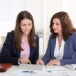 Teamwork: two business woman working together. — Stock Photo