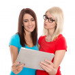 Isolated two young students having fun with digital tablet. — Stock Photo #43287283