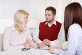 Consultation with young attractive couple at office. — Stockfoto