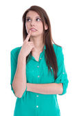 Isolated young pondering woman in green blouse on white. — Stock Photo