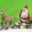 Christmas decoration: Santa Claus with sledge and reindeer. — Stock Photo