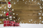 Christmas tree with red presents and snowflakes. — Stock Photo