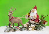 Christmas decoration: Santa Claus with sledge and reindeer. — Zdjęcie stockowe