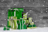 On wooden background different green christmas presents. — Photo