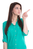 Isolated young woman is presenting or pointing with her finger. — Stock Photo