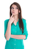 Isolated young pondering female student in green blouse on white — Stock Photo