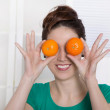 Young woman smiling with orange eyes. — Stock Photo #44952619
