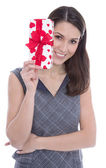 Isolated woman holding a present with red hearts. — Stock Photo