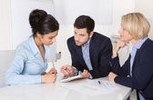 Successful business collaboration - man and two woman. — Stock Photo