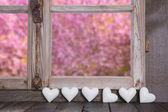Wooden window with garden view and white hearts — Zdjęcie stockowe