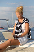 Cruising: Sail woman working on holidays at the boat. — Stock Photo