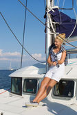 Cruising: Sailing woman on a luxury sail boat in summer. — Stockfoto